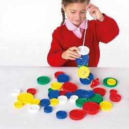 Veľké navliekacie gombíky
